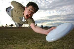 Overenthusiastic frisbee player laying out for a disc.
